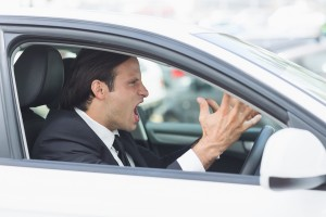 businessman with road rage in a car