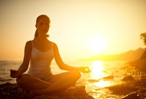 bigstock-Woman-Meditating-In-Lotus-Pose-61039754-300x203