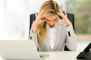 over-worked business woman sitting
