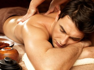 bigstock-Masseur-doing-back-massage-on-61658324-300x225