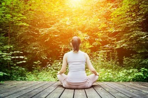 bigstock-Young-woman-meditating-in-a-fo-68759434-300x200